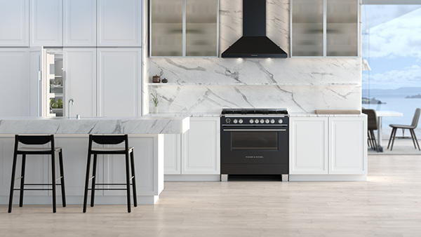 White and Bright Kitchen featuring a Black Classic Range and Matching Rangehood.