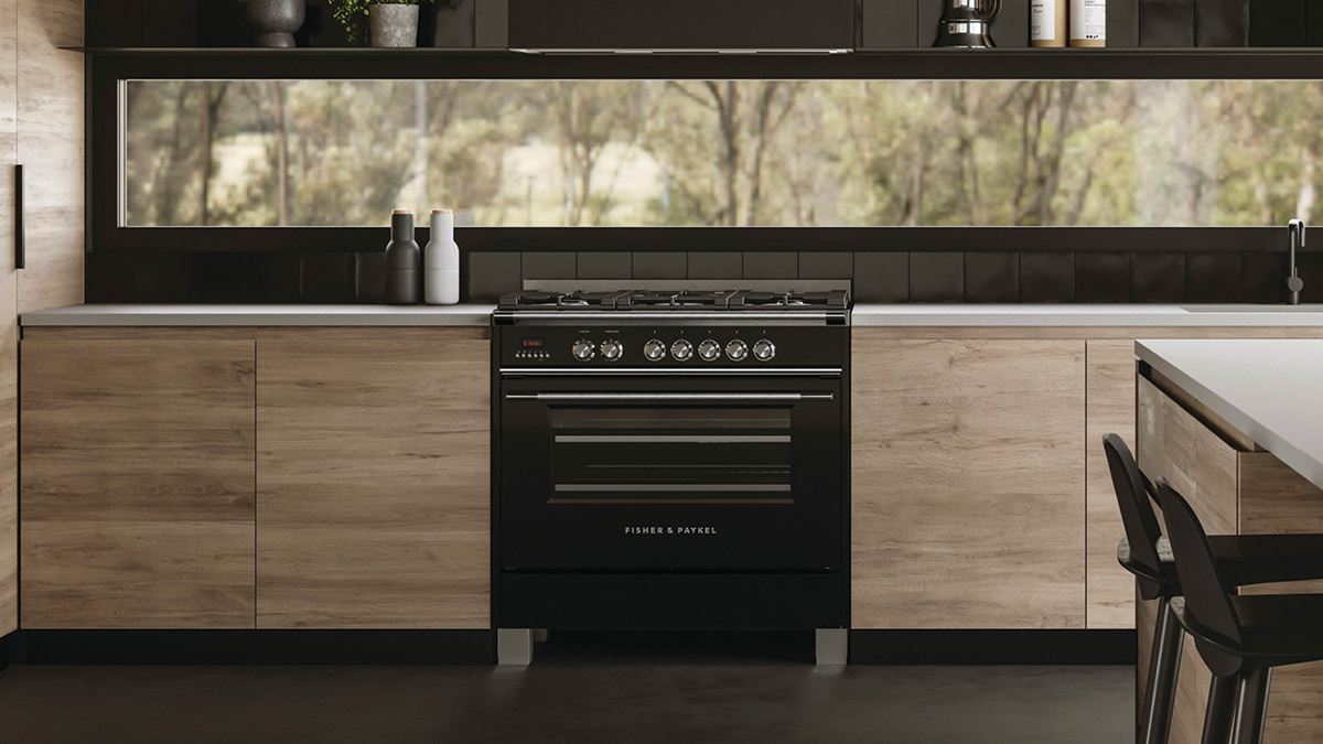 Frontview of a White Classic Range Cooker in a Display Kitchen with Grey Cabinetry